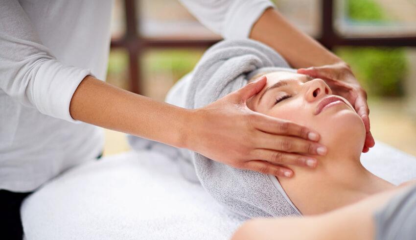 A woman receiving a facial massage