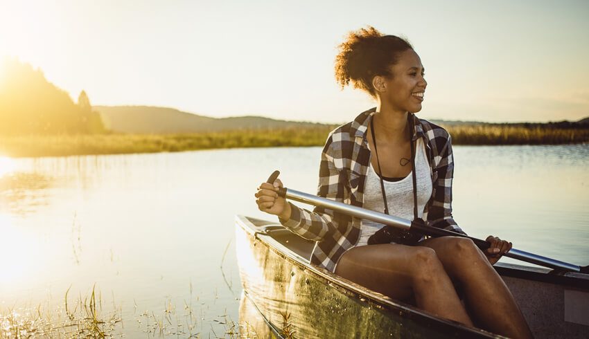 Woman on a boat under the sun