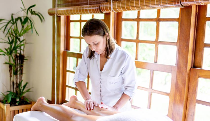 a massage therapist giving a client a massage